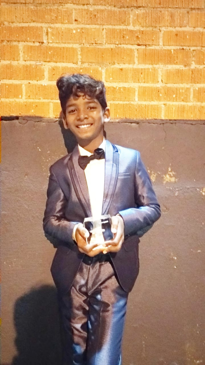 Sunny Pawar with his Best Child Actor award at New York Indian Film Festival